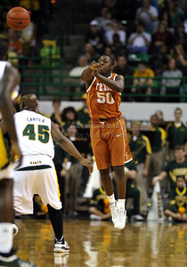 March 6th, 2010:   Texas Longhorns J'Covan Brown #50 Guard brings the ball forward in a NCAA basketball game between the Texas Longhorns and the Baylor Bears at the Ferrell Coliseum in Waco, Texas. Baylor wins 92-77
