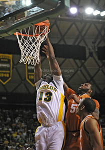 March 6th, 2010:   Baylor Bears Ekpe Udoh #13 F/C gets a dunk in a NCAA basketball game between the Texas Longhorns and the Baylor Bears at the Ferrell Coliseum in Waco, Texas. Baylor wins 92-77