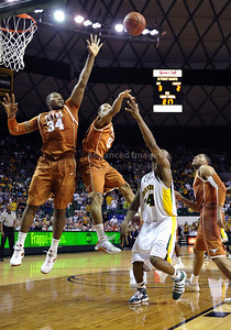March 6th, 2010:   Texas Longhorns Dexter Pittman #34 and Avery Bradley #0 try to block a shot in a NCAA basketball game between the Texas Longhorns and the Baylor Bears at the Ferrell Coliseum in Waco, Texas. Baylor wins 92-77