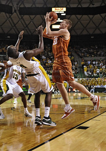 March 6th, 2010:   Texas Longhorns Clint Chapman #53 F/C is called for an offensive foul against Baylor Bears Quincy Acy #4 Forward in a NCAA basketball game between the Texas Longhorns and the Baylor Bears at the Ferrell Coliseum in Waco, Texas. Baylor wins 92-77