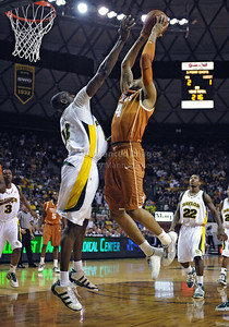 March 6th, 2010:   Baylor Bears Ekpe Udoh #13 F/C in action against Texas Longhorn Gary Johnson #4 F in a NCAA basketball game between the Texas Longhorns and the Baylor Bears at the Ferrell Coliseum in Waco, Texas. Baylor wins 92-77
