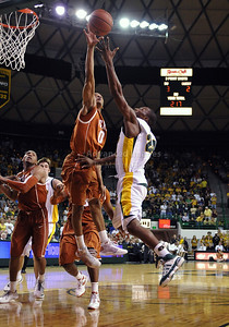 March 6th, 2010:   Texas Longhorns Avery Bradley #0 blocks a shot against Baylor Bears  Lacedarius Dunn #24 Guard in a NCAA basketball game between the Texas Longhorns and the Baylor Bears at the Ferrell Coliseum in Waco, Texas. Baylor wins 92-77