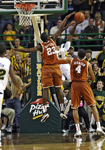 March 6th, 2010:   Baylor Bears Ekpe Udoh #13 F/C has his shot blocked from behind by Texas Longhorns #23 Jordan Hamilton G/F in a NCAA basketball game between the Texas Longhorns and the Baylor Bears at the Ferrell Coliseum in Waco, Texas. Baylor wins 92-77