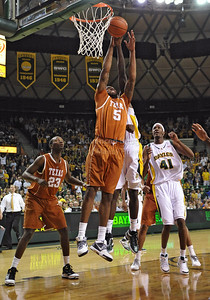 March 6th, 2010:   Texas Longhorns Damion James #5 G/F gets a rebound in a NCAA basketball game between the Texas Longhorns and the Baylor Bears at the Ferrell Coliseum in Waco, Texas. Baylor wins 92-77