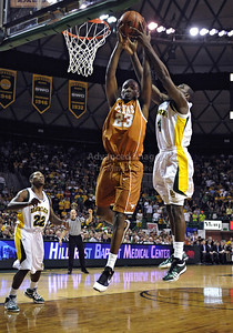 March 6th, 2010:   Baylor Bears Quincy Acy #4 Forward fights for a rebound against Texas Longhorn Jordan Hamilton #23 G/F in a NCAA basketball game between the Texas Longhorns and the Baylor Bears at the Ferrell Coliseum in Waco, Texas. Baylor wins 92-77