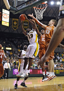 March 6th, 2010:   Baylor Bears Ekpe Udoh #13 F/C gets a rebound in a NCAA basketball game between the Texas Longhorns and the Baylor Bears at the Ferrell Coliseum in Waco, Texas. Baylor wins 92-77