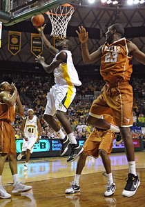 March 6th, 2010:   Baylor Bears Quincy Acy #4 Forward gets a dunk in a NCAA basketball game between the Texas Longhorns and the Baylor Bears at the Ferrell Coliseum in Waco, Texas. Baylor wins 92-77