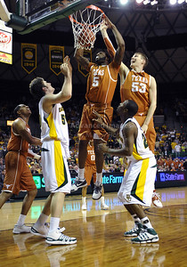 March 6th, 2010:   Texas Longhorns Damion James #5 G/F gets a dunk off of a rebound in a NCAA basketball game between the Texas Longhorns and the Baylor Bears at the Ferrell Coliseum in Waco, Texas. Baylor wins 92-77