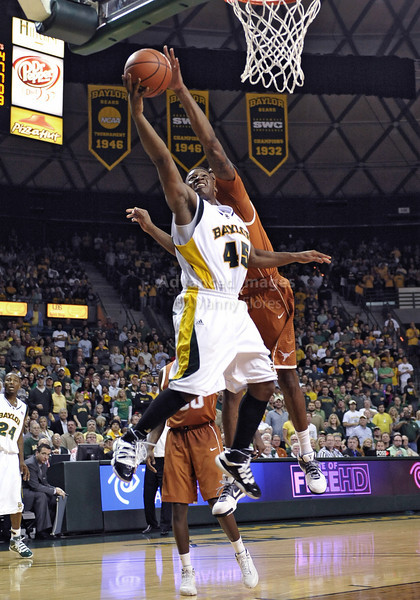 March 6th, 2010:  <br /> Texas Longhorns Damion James #5 G/F blocks a shot by Baylor Bears Tweety Carter #45 Guard as he drives to the basket in a NCAA basketball game between the Texas Longhorns and the Baylor Bears at the Ferrell Coliseum in Waco, Texas.<br /> Baylor wins 92-77