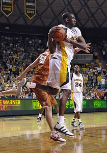 March 6th, 2010:   Baylor Bears Ekpe Udoh #13 F/C ges a rebound in a NCAA basketball game between the Texas Longhorns and the Baylor Bears at the Ferrell Coliseum in Waco, Texas. Baylor wins 92-77