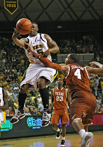March 6th, 2010:   Baylor Bears Tweety Carter #45 Guard drives to the basket against Texas Longhorn Gary Johnson #4 F in a NCAA basketball game between the Texas Longhorns and the Baylor Bears at the Ferrell Coliseum in Waco, Texas. Baylor wins 92-77