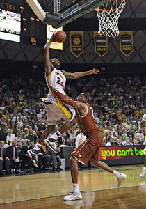 March 6th, 2010:   Baylor Bears Lacedarius Dunn #24 Guard gets a dunk in a NCAA basketball game between the Texas Longhorns and the Baylor Bears at the Ferrell Coliseum in Waco, Texas. Baylor wins 92-77