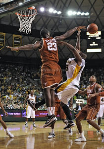 March 6th, 2010:   Baylor Bears Tweety Carter #45 Guard drives to the basket against Texas Longhorns Jordan Hamilton #23 G/F in a NCAA basketball game between the Texas Longhorns and the Baylor Bears at the Ferrell Coliseum in Waco, Texas. Baylor wins 92-77