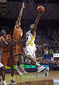 March 6th, 2010:   Baylor Bears Lacedarius Dunn #24 Guard drives to the basket against Texas Longhorns Avery Bradley #0 Guard in a NCAA basketball game between the Texas Longhorns and the Baylor Bears at the Ferrell Coliseum in Waco, Texas. Baylor wins 92-77
