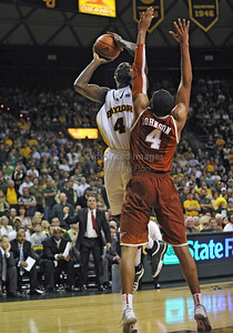 March 6th, 2010:   Baylor Bears Quincy Acy #4 Forward shoots over Texas Longhorn Gary Johnson #4 F in a NCAA basketball game between the Texas Longhorns and the Baylor Bears at the Ferrell Coliseum in Waco, Texas. Baylor wins 92-77