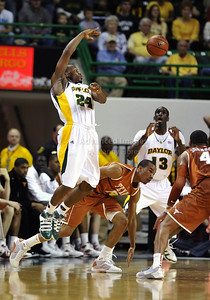 March 6th, 2010:   Baylor Bears Lacedarius Dunn #24 Guard passes the ball in a NCAA basketball game between the Texas Longhorns and the Baylor Bears at the Ferrell Coliseum in Waco, Texas. Baylor wins 92-77