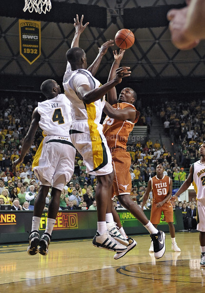 March 6th, 2010:  <br /> Baylor Bears Ekpe Udoh #13 F/C and Baylor Bears Quincy Acy #4 Forward try to block Texas Longhorns Jordan Hamilton #23 in a NCAA basketball game between the Texas Longhorns and the Baylor Bears at the Ferrell Coliseum in Waco, Texas.<br /> Baylor wins 92-77