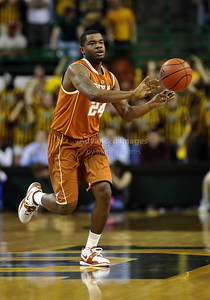 March 6th, 2010:   Texas Longhorns Justin Mason #24 Guard passes the ball in a NCAA basketball game between the Texas Longhorns and the Baylor Bears at the Ferrell Coliseum in Waco, Texas. Baylor wins 92-77