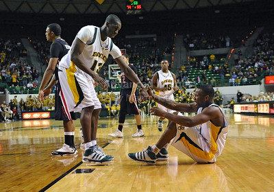 Feb 16th, 2010:   Baylor F/C Ekpe Udoh #13 helps teammate Quincy Acy #4 get off the floor after a hard foul during a NCAA Basketball game between the Texas Tech Red Raiders and the Baylor Bears at the Ferrell Center at Waco, Texas Baylor wins 88-70