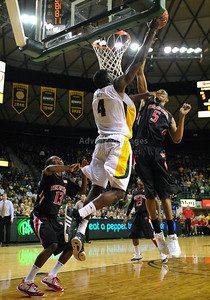 Feb 16th, 2010:   Baylor Forward Quincy Acy #4 gets a rebound and is fouled by Texas Tech Forward D'walyn Roberts #5 during a NCAA Basketball game between the Texas Tech Red Raiders and the Baylor Bears at the Ferrell Center at Waco, Texas Baylor wins 88-70