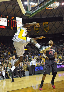 Feb 16th, 2010:   Baylor Forward Quincy Acy #4 gets a dunk during a NCAA Basketball game between the Texas Tech Red Raiders and the Baylor Bears at the Ferrell Center at Waco, Texas Baylor wins 88-70