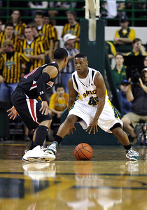 Feb 16th, 2010:   Baylor Guard Tweety Carter #45 bounces the ball between his legs during a NCAA Basketball game between the Texas Tech Red Raiders and the Baylor Bears at the Ferrell Center at Waco, Texas Baylor wins 88-70