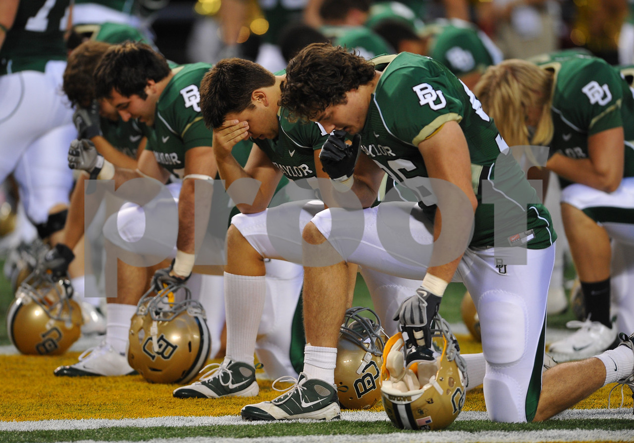 November 28th, 2009:  <br /> Baylor players have a moment in silence before kick off during a NCAA Football game between the Baylor Bears and theTexas Tech Red Raiders at Cowboy Stadium in Arlington, TX.  <br /> Texas Tech wins 20-13.