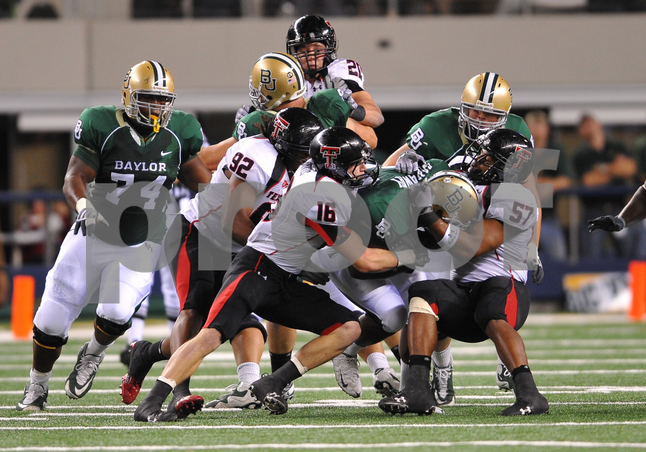 November 28th, 2009:  <br /> Baylor running back Terrance Ganaway #24 & Texas Tech linebacker Brian Duncan #57 in action during a NCAA Football game between the Baylor Bears and theTexas Tech Red Raiders at Cowboy Stadium in Arlington, TX.  <br /> Texas Tech wins 20-13.