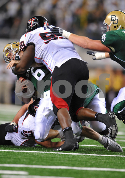 November 28th, 2009:  <br /> Texas Tech defensive tackle Richard Jones #99 hits Baylor quarterback Blake Szymanski #6 during a NCAA Football game between the Baylor Bears and theTexas Tech Red Raiders at Cowboy Stadium in Arlington, TX.  <br /> Texas Tech wins 20-13.