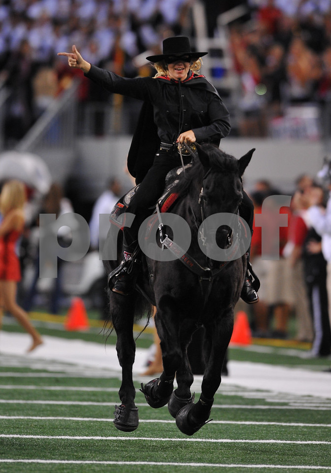 November 28th, 2009:  <br /> Red Raider Mascot takes the field as team prepares to enter field during a NCAA Football game between the Baylor Bears and theTexas Tech Red Raiders at Cowboy Stadium in Arlington, TX.  <br /> Texas Tech wins 20-13.