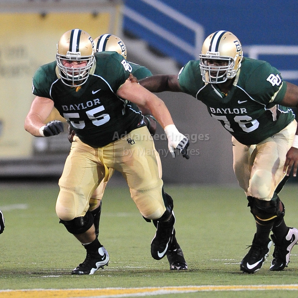 September 26th 2009:  <br /> Baylor center J.D. Walton #55 & Baylor guard Ivory Wade #76<br /> in action during a NCAA Football game between the Baylor Bears and the Northwestern State Demons at Floyd Casey  Stadium in Waco, TX.  <br /> Baylor wins 68-13