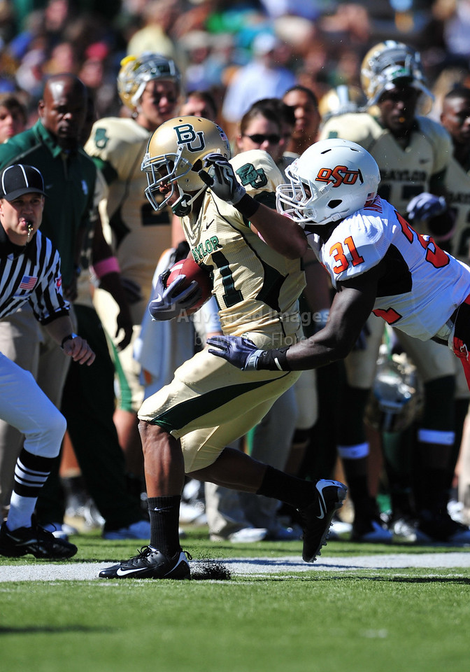 October 24th, 2009:  <br /> Baylor running back Jarred Salubi #21 & Oklahoma State safety Lucien Antoine #31 in action during a NCAA Football game between the Oklahoma State Cowboys and Baylor Bears at Floyd Casey  Stadium in Waco, TX.  <br /> Oklahoma State wins 34-7.