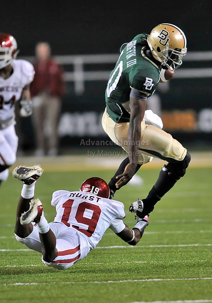 20 Nov 2010:  <br /> Baylor Bears quarterback Robert Griffin III #10 tries to elude Oklahoma Sooners cornerback Demontre Hurst #19 of their NCAA football game between the Oklahoma Sooners and the Baylor Bears at Floyd Casey Stadium in Waco, Texas.<br /> Oklahoma wins 53-24.
