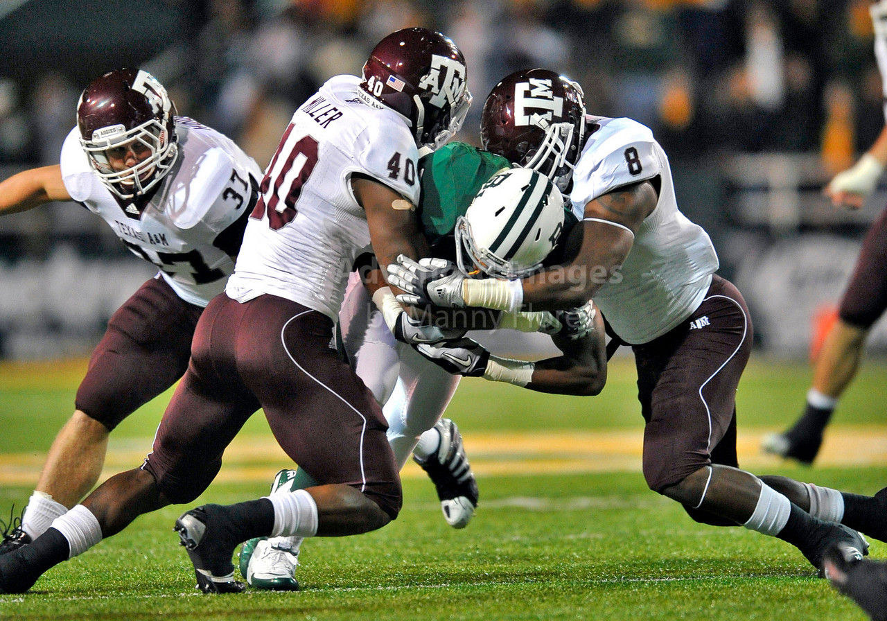13 Nov 2010:  <br /> Texas A&M Aggies defensive end Von Miller #40 and Texas A&M Aggies linebacker Garrick Williams #8 make a tackle as Baylor Bears running back Jay Finley #23 tries to get a first down<br /> of their NCAA football game between the Texas A&M Aggies and the Baylor Bears at Floyd Casey Stadium in Waco, Texas.<br /> The Aggies beat the Bears 42-30.