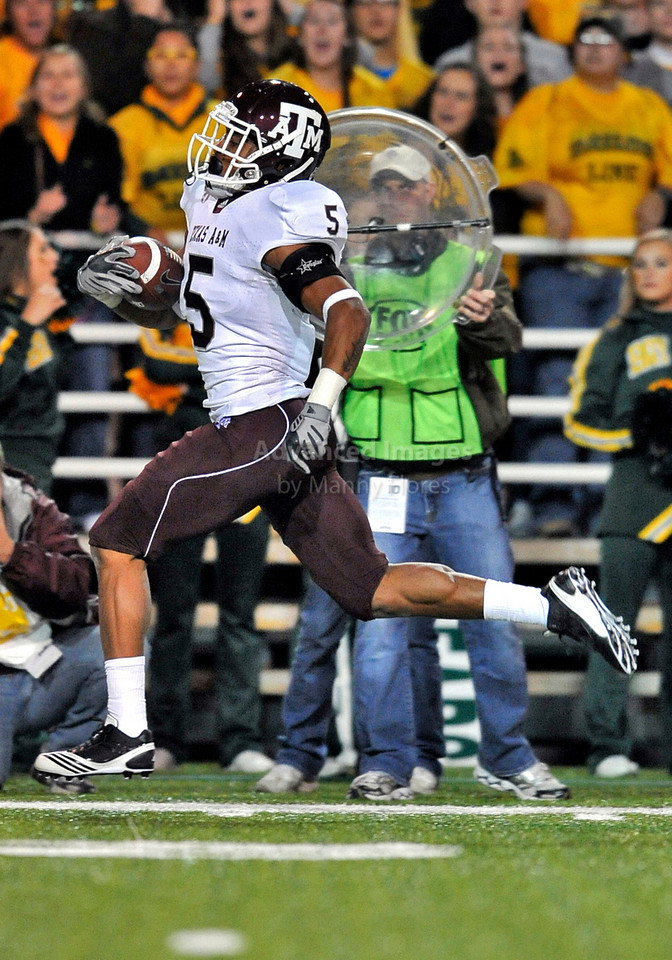 13 Nov 2010:  <br /> Texas A&M Aggies cornerback Coryell Judie #5 returns a kickoff for a touchdown in the first half of their NCAA football game between the Texas A&M Aggies and the Baylor Bears at Floyd Casey Stadium in Waco, Texas.<br /> The Aggies beat the Bears 42-30.