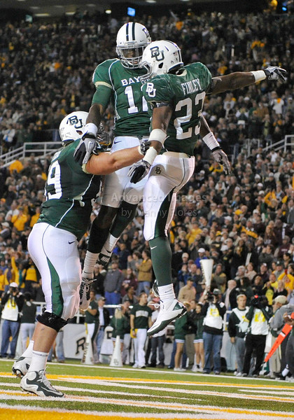 13 Nov 2010:  <br /> Baylor Bears running back Jay Finley #23 and Baylor Bears wide receiver Josh Gordon #12 and Baylor Bears offensive tackle Danny Watkins #59 celebrate a touchdown <br /> of their NCAA football game between the Texas A&M Aggies and the Baylor Bears at Floyd Casey Stadium in Waco, Texas.<br /> The Aggies beat the Bears 42-30.