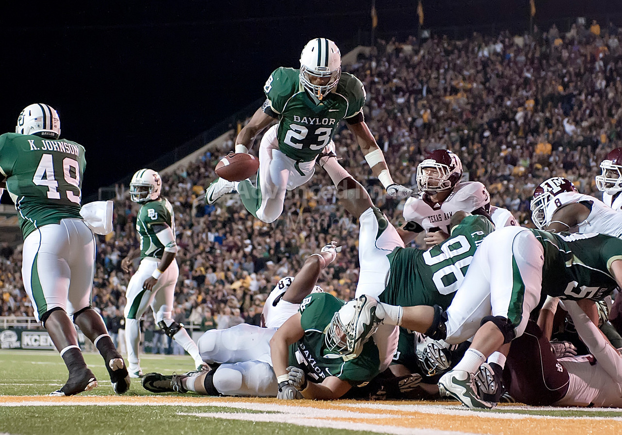 13 Nov 2010:  <br /> Baylor Bears running back Jay Finley #23 leaps over everybody as he scores a touchdown of their NCAA football game between the Texas A&M Aggies and the Baylor Bears at Floyd Casey Stadium in Waco, Texas.<br /> The Aggies beat the Bears 42-30.