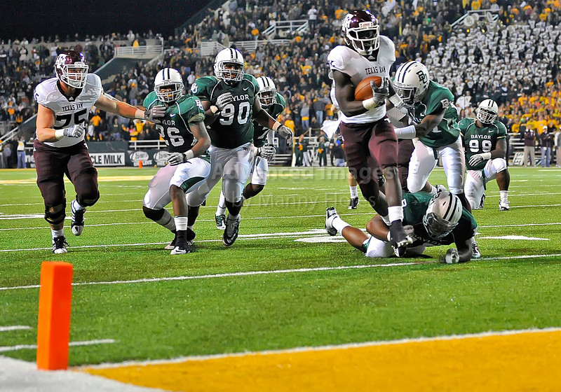 13 Nov 2010:  <br /> Texas A&M Aggies running back Cyrus Gray #32 eludes a baylor defender of their NCAA football game between the Texas A&M Aggies and the Baylor Bears at Floyd Casey Stadium in Waco, Texas.<br /> The Aggies beat the Bears 42-30.