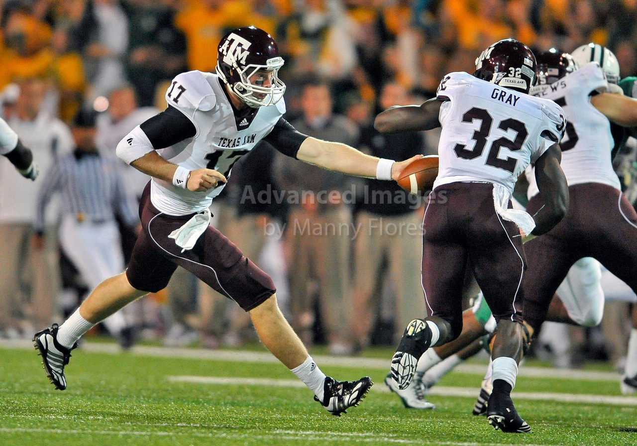 13 Nov 2010:  <br /> Texas A&M Aggies quarterback Ryan Tannehill #17 hands the ball off to Texas A&M Aggies running back Cyrus Gray #32<br /> of their NCAA football game between the Texas A&M Aggies and the Baylor Bears at Floyd Casey Stadium in Waco, Texas.<br /> The Aggies beat the Bears 42-30.