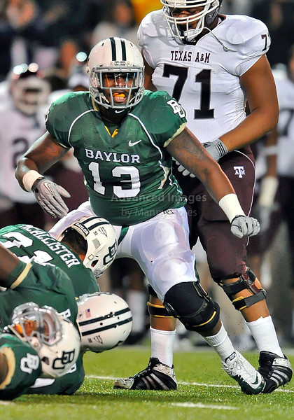 13 Nov 2010:  <br /> Baylor Bears defensive tackle Tracy Robertson #13 in action<br /> of their NCAA football game between the Texas A&M Aggies and the Baylor Bears at Floyd Casey Stadium in Waco, Texas.<br /> The Aggies beat the Bears 42-30.