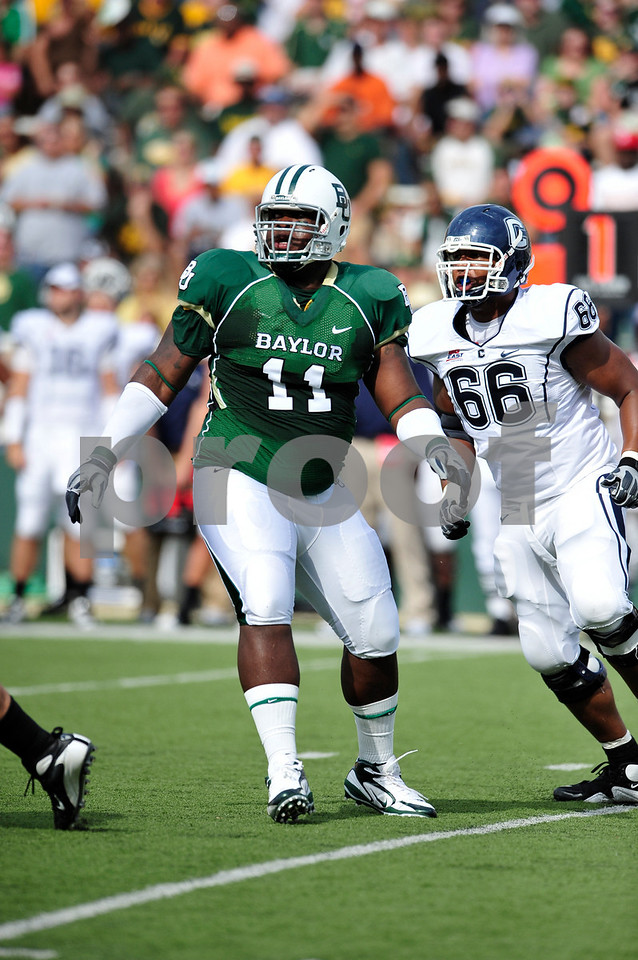September 19th 2009:  <br /> Baylor defensive tackle Phillip Taylor (11)<br /> in action during a NCAA Football game between the Baylor Bears and the University of Connecticut at Floyd Casey  Stadium in Waco, TX.  <br /> Baylor loses to UConn 30-22