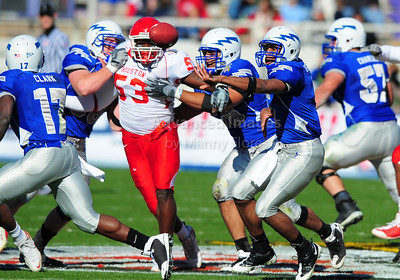 December 31, 2008:   Air Force quarterback Eric Herbort #7 Houston defensive end Phillip Hunt #53 in action during the NCAA Football game between the Houston Cougars and the Air Force Falcons at the Bell Helicopter Armed Forces Bowl in Ft. Worth, TX.  Houston defeated Air Force 34-28. Manny Flores/CSM