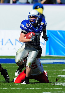 December 31, 2008:   Air Force WR Spencer Armstrong #26 Houston linebacker Marcus McGraw #55 in action during the NCAA Football game between the Houston Cougars and the Air Force Falcons at the Bell Helicopter Armed Forces Bowl in Ft. Worth, TX.  Houston defeated Air Force 34-28. Manny Flores/CSM