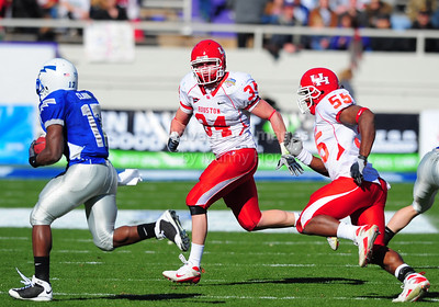 December 31, 2008:   Houston linebacker Cody Lubojasky #34 Air Force TB Asher Clark #17 in action during the NCAA Football game between the Houston Cougars and the Air Force Falcons at the Bell Helicopter Armed Forces Bowl in Ft. Worth, TX.  Houston defeated Air Force 34-28. Manny Flores/CSM