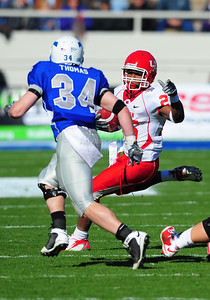 December 31, 2008:   Houston running back Bryce Beall #25 & Air Force safety Chris Thomas #34 in action during the NCAA Football game between the Houston Cougars and the Air Force Falcons at the Bell Helicopter Armed Forces Bowl in Ft. Worth, TX.  Houston defeated Air Force 34-28. Manny Flores/CSM