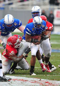 December 31st  2009:   Houston defensive tackle David Hunter #95 tackles Air Force quarterback Tim Jefferson #7 during the Armed Forces Bowl NCAA Football game between the Air Force Falcons and the Houston Cougars at Amon G. Carter Stadium in Ft. Worth, TX.   Air Force wins 47-20