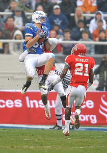 December 31st  2009:   Air Force wide receiver Kevin Fogler #83 catches the ball for a 37 yard gain which sets up a touchdown to put Air Force up 14-0 during the Armed Forces Bowl NCAA Football game between the Air Force Falcons and the Houston Cougars at Amon G. Carter Stadium in Ft. Worth, TX.   Air Force wins 47-20