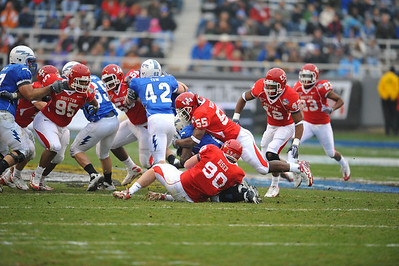 December 31st  2009:   Houston linebacker Marcus McGraw #55 & Houston defensive lineman Zeke Riser #90 get a tackle for a loss during the Armed Forces Bowl NCAA Football game between the Air Force Falcons and the Houston Cougars at Amon G. Carter Stadium in Ft. Worth, TX.   Air Force wins 47-20
