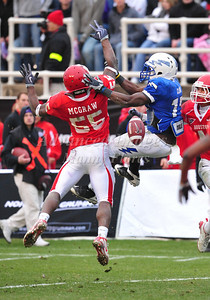 December 31st  2009:   Houston linebacker Marcus McGraw #55 breaks up a pass intended to Air Force quarterback Asher Clark #17 during the Armed Forces Bowl NCAA Football game between the Air Force Falcons and the Houston Cougars at Amon G. Carter Stadium in Ft. Worth, TX.   Air Force wins 47-20