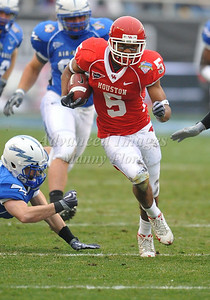 December 31st  2009:   Houston running back Charles Sims #5 runs for a big gain during the Armed Forces Bowl NCAA Football game between the Air Force Falcons and the Houston Cougars at Amon G. Carter Stadium in Ft. Worth, TX.   Air Force wins 47-20